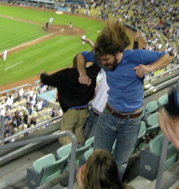 Crazy Dodger fans stomp and make noise at the Stadium.jpg