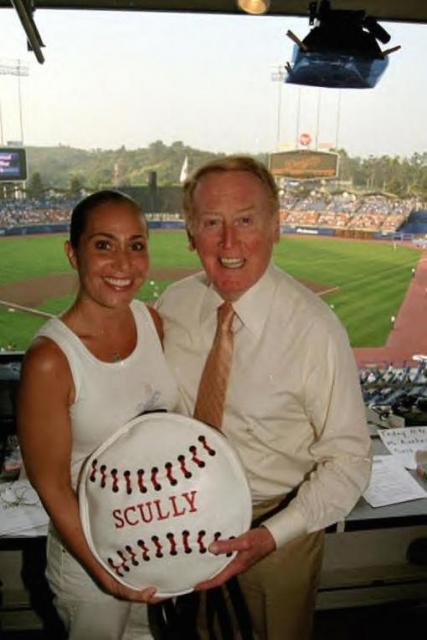 Vin Scully poses with a woman fan.jpg
