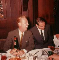 A younger Vin Scully has a laugh at the dinner table.jpg