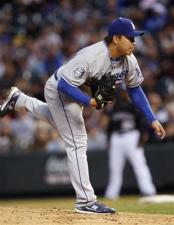 Hong-Chi Kuo follows through after throwing a pitch.jpg