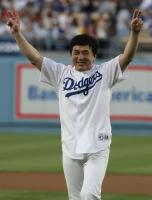 Dodger Fan Jackie Chan smiles after throwing the first pitch.jpg
