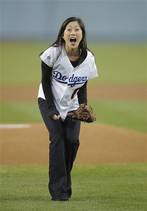 Dodger fan Kristy Yamaguchi reacts after throwing out the first pitch.jpg