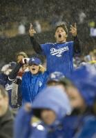 Dodger fans cheer on their team during the rain.jpg