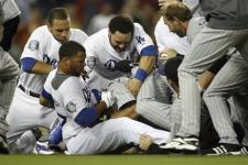 Kemp battles Torrealba as his teammates tries to untangle the mess.jpg