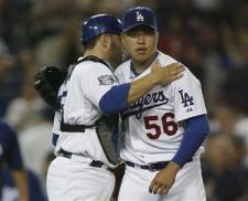 Hong-Chih Kuo is congratulated by Russell Martin.jpg