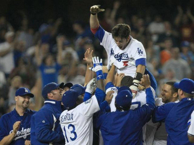 Nomar is picked up by his teammates after hitting a game winning homer.jpg