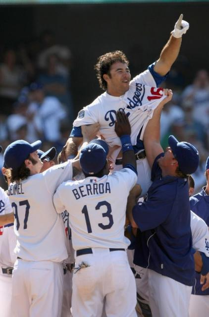 Andre Ethier wins the game for the Dodgers and is picked up by his teammates.jpg