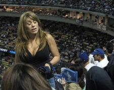 Dodger woman fan with big ones.jpg