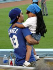 A little Dodger fan with Manny dreads.jpg