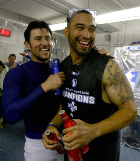 Nomar Garciaparra and Matt Kemp have a laugh during the celebration.jpg