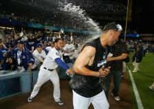 Russell Martin lets the champagne loose.jpg