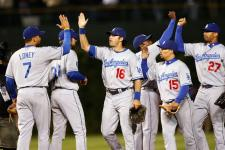 Dodger team high five each other after the game 1 NLDS win.jpg