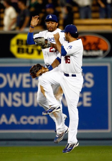 Matt Kemp and Andre Ethier bump to celebrate a win.jpg