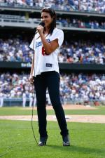 Dodger fan Nadia Bjorlin sings during a Dodger game.jpg