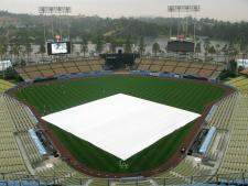 Dodger Stadium infield covered by tarp.jpg