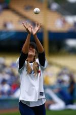 Dodger fan Lauren Conrad catches a baseball.jpg