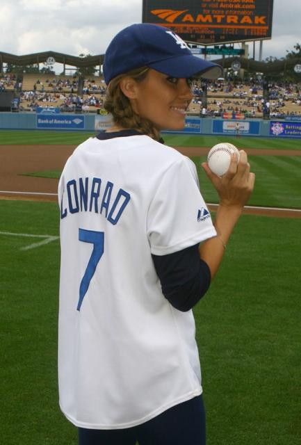 Dodger fan Lauren Conrad holds a baseball.jpg
