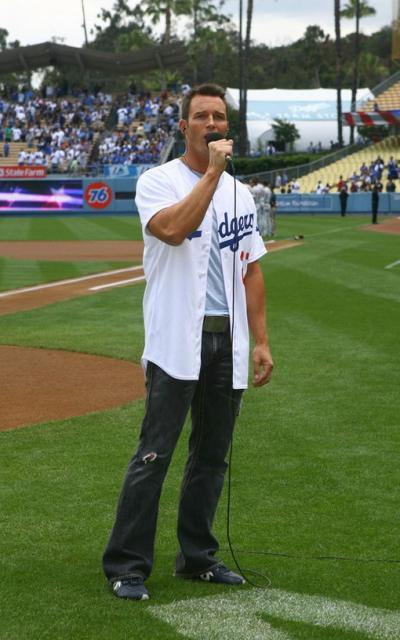Dodger Fan Eric Martsolf performs the National Anthem before the game.jpg