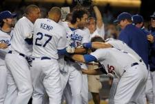 Andre Ethier is mobbed by teammates after hitting the game winning home run.JPG