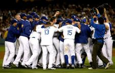 Dodgers teammates gather together in celebration as they clinch the NL West in 2009.JPG