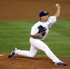 Hong-Chi Kuo throws a pitch against the Cardinals in game 1 of the NLDS.JPG