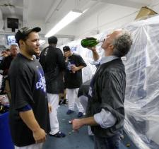 Russell Martin looks at Frank McCourt drinking champagne from the bottle.JPG