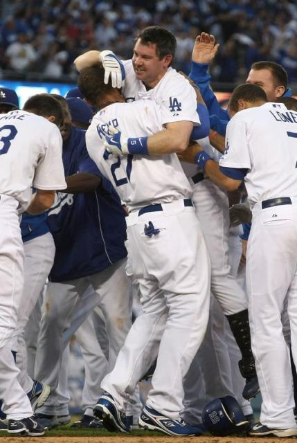 Mark Loretta gets a bear hug from Matt Kemp as Dodgers celebrate their 2009 NLDS game 2 victory.JPG