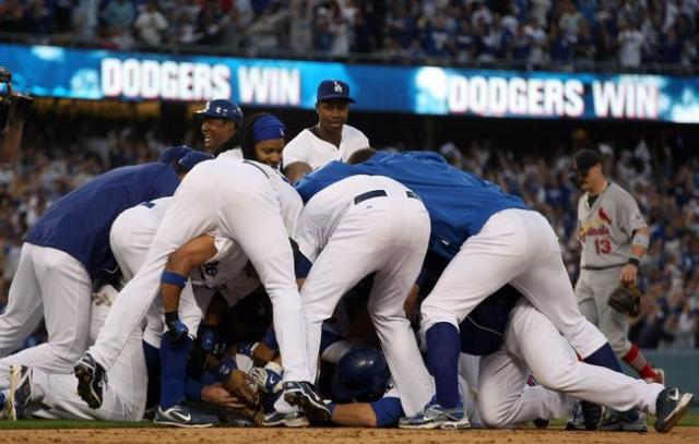 Dodger players pile on top of Mark Loretta after their dramatic 3-2 win over the Cardinals in game 2 of the 2009 NLDS.JPG