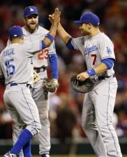Furcal Blake and Loney celebrate Dodger's sweep of St Louis.JPG
