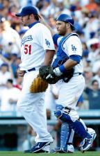 Jonathan Broxton and Russell Martin walk off the field after the Dodgers win game 2 of the 2009 NLCS.JPG