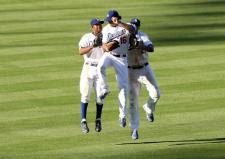 Juan Pierre Matt Kemp and Andre Ethier body bump in the outfield after the Dodgers win game 2.JPG