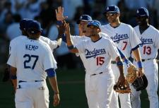 Dodgers congratulate one another after taking game 2 of the 2009 NLCS from the Phillies.JPG