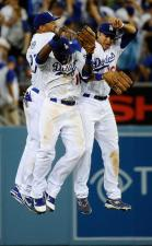 Dodgers 2011 Outfielders Matt Kemp Marcus Thames and Andre Eithier leap into each other in celebration.JPG