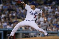 Hong Chi Kuo throws a pitch in the 8th inning.JPG